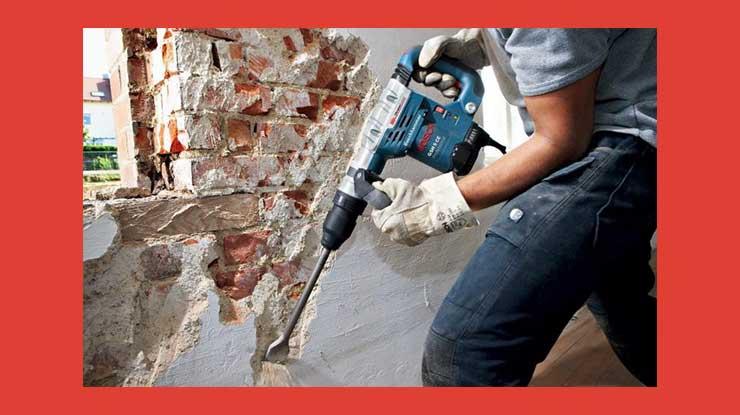 Proses Pembongkaran Dinding Bangunan